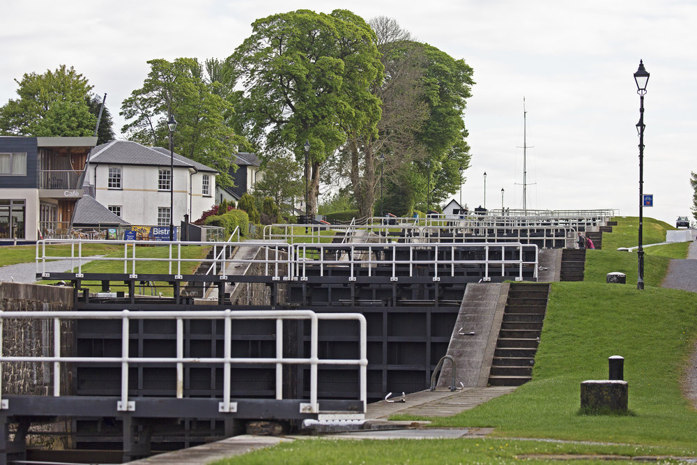 You can just see the mast of the sailboat in the top lock.  It's going to take them awhile to make it all the way down.