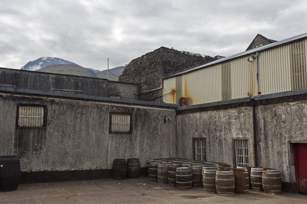 A small part of the original distillery wall that remains from 1825.  Ben Nevis mountain rises above which is where their water comes from.