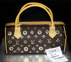 Some Specialty cakes such as this purse require the use of fondant. In this case the entire cake from the handle and zipper, to the smooth brown bag are made in fondant.