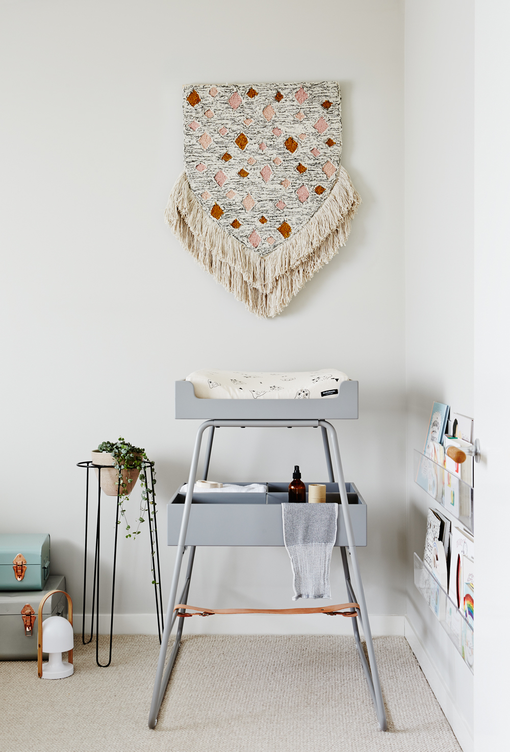 THAT wall hanging... THIS change table...perfect pieces from  Designstuff . Styling:  Simone Hagg.  Photography:  Annette O'Brien .
