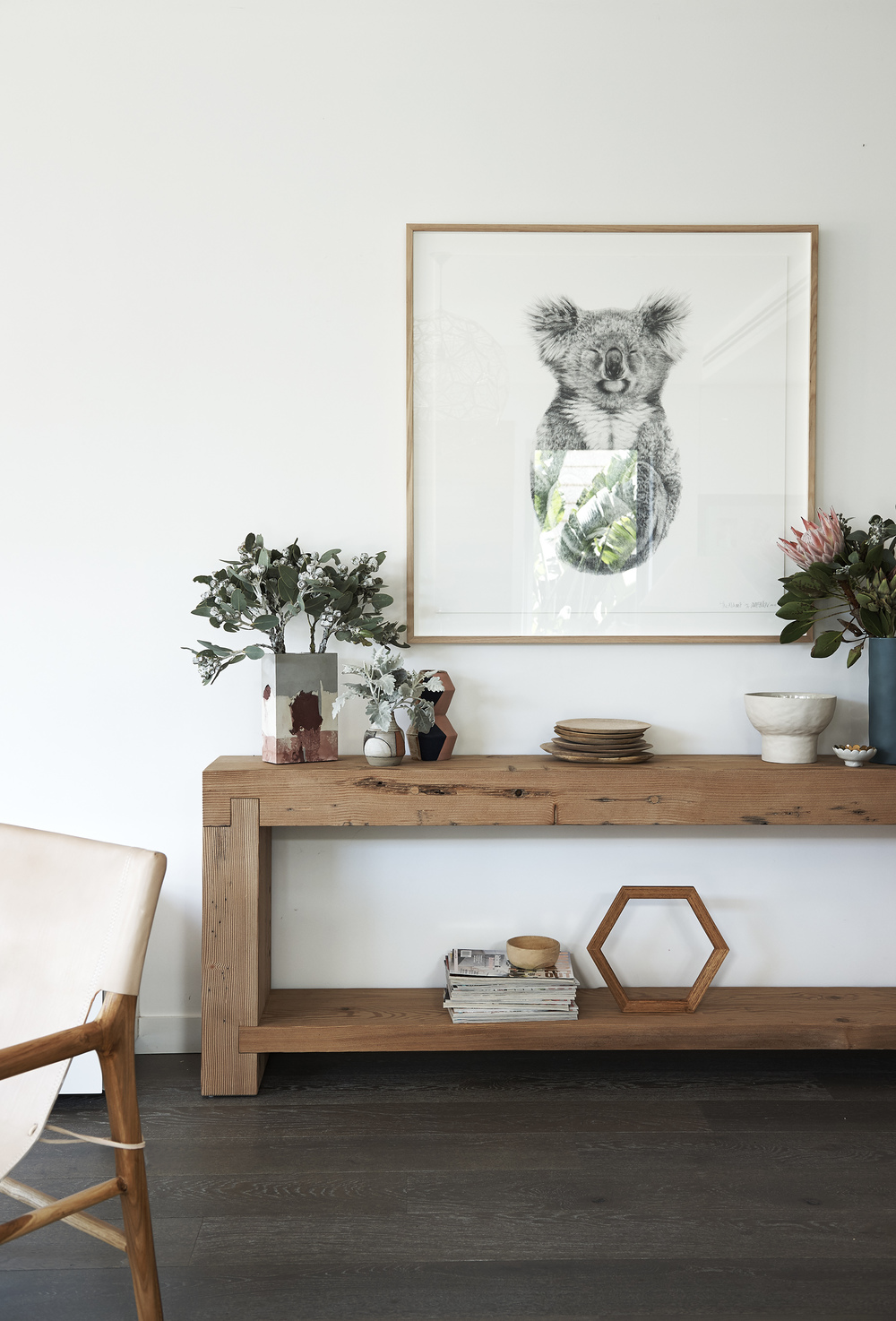 A beautifully chunky  Mark Tuckey  console table is filled with ceramics by  Marmouset Found  and  Studio Twocan . Above hangs 'The Alchemist' limited edition print by  Carla Fletcher . A stack of mango plates from the  House of Orange  and a custom made timber hexagon were stained with Feast Watson's  Traditional timber oil .