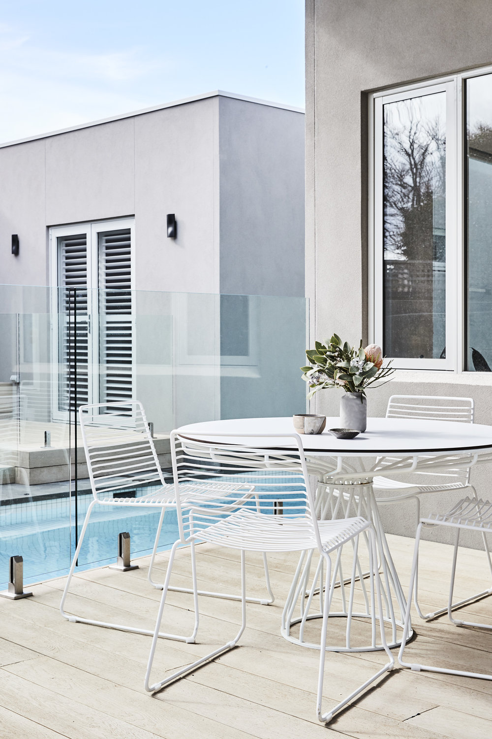 Velletri outdoor dining table with white laminate top and chairs,  Huset .