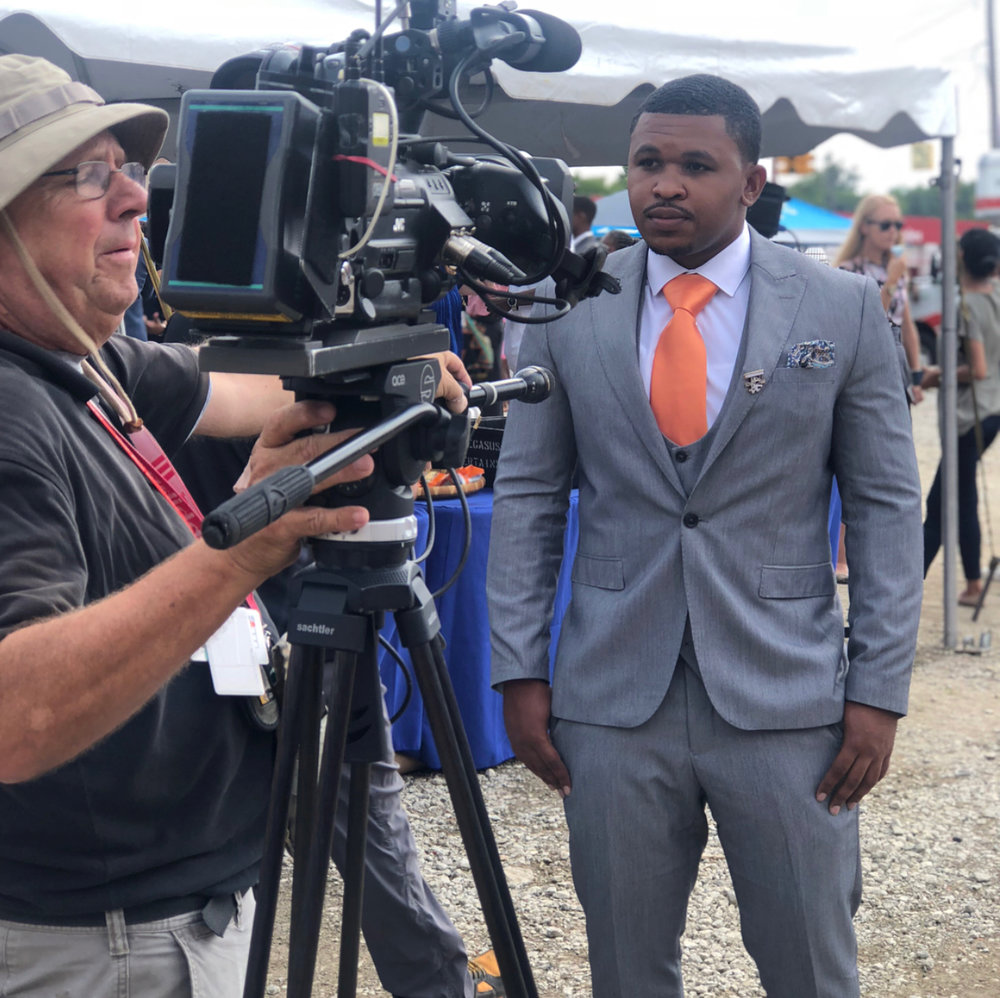 Eddie Kidd standing with camera man just before an interview with Fox 2 News after becoming a grant recipient. Picture retrieved from Eddie via IG: gg.kidd