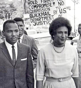 James Meredith and NAACP Attorney Motley being picketed at the Federal Courthouse in Louisiana in the desegregation case at the University of Mississippi; Medgar Evers, Civil Rights leader, is behind Meredith. 1962 Martin Luther King with his wife Coretta (l) and Constance Baker Motley at SCLC Convention honoring Rosa Parks, 1965