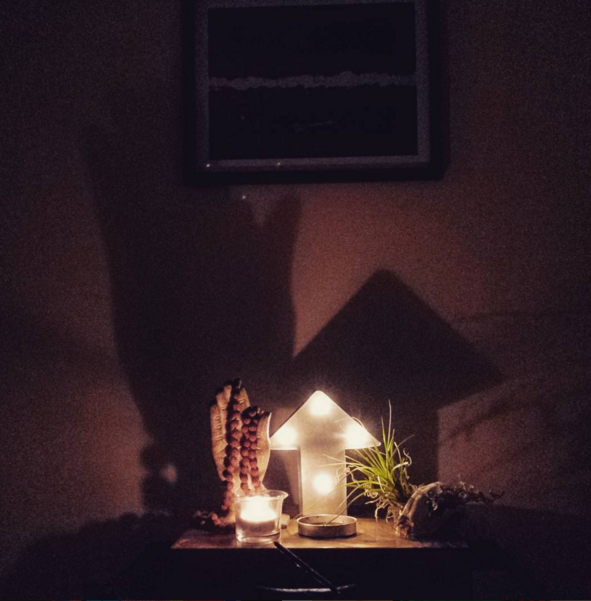 Lit candle on my altar the first night of yoga teacher training (instagram @raglande)