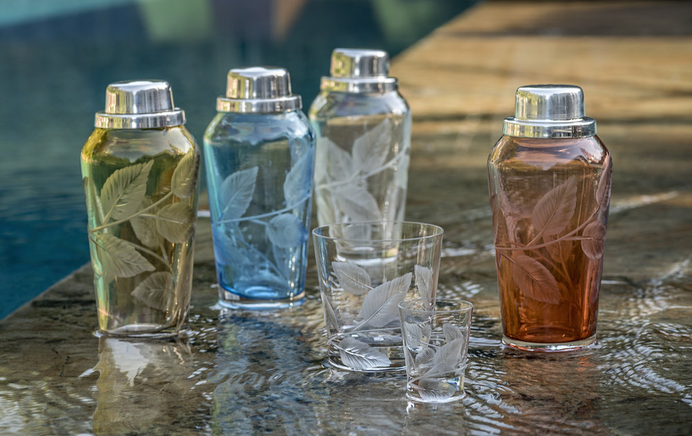Shakers in amber, sky blue, clear and sunset / Whiskey and shot glasses /All in spring cut