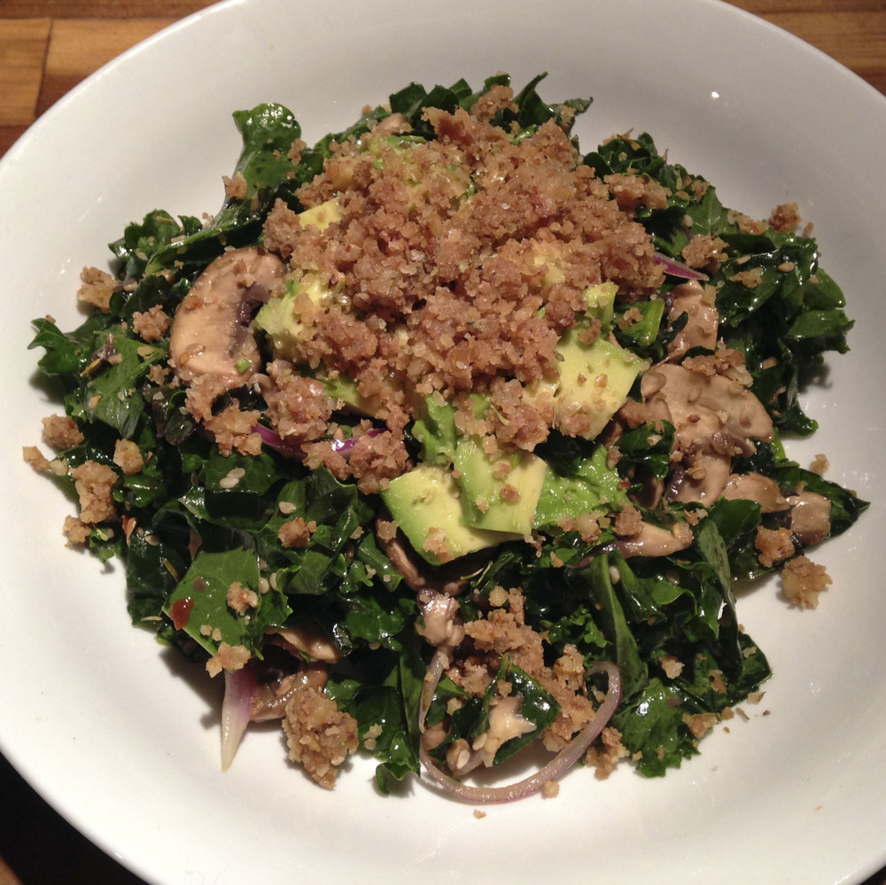 angelaisraw: Kale Mushroom Salad with Walnut Crumble and Avocado Serves 2-4 Ingredients: 4-6 cups kale, chopped 6 shiitake mushrooms, thinly sliced 6 crimini mushrooms, sliced 1 raw shallot, sliced 1 tbsp olive oil 1 tbsp sesame oil 2 tbsp rice vinegar 1 tbsp tamari 2 tsp raw agave nectar or honey ¼ tsp red pepper flakes 1 tsp thyme 1 tsp garlic powder 2 tbsp sesame seeds, toasted 1 cup walnuts ¼ cup nutritional yeast ¼ tsp sea salt 1 clove garlic 1 tsp thyme 2 tbsp water (to facilitate blending) 1 avocado, sliced Directions: In a large bowl, combine kale, mushrooms, and shallot.  In a small bowl, whisk together olive oil, sesame oil, rice vinegar, tamari, agave nectar, red pepper flakes, thyme, garlic, and sesame seeds.  Pour dressing over kale mixture and toss to combine.  Set aside. For the walnuts, combine walnuts, nutritional yeast, sea salt, garlic and thyme in a food processor and process until finely chopped.  Add a couple Tbsp of water and pulse until it holds together in clumps. To assemble, place kale on a large plate, top with avocadoes and walnuts and serve! Angela says: I substituted red onion for the shallot, coconut aminos for the tamari, apple cider vinegar for rice vinegar, and skipped toasting the sesame seeds. I let the veggies marinade for an hour before adding the walnut crumble and avocado and serving. This is an incredibly flavorful dish I will be making again and again!