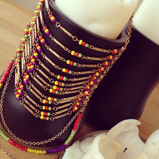 "Today calls for celebration! Do it in style with our beaded #bibnecklace! —> Then get right back to work, cuz like @Casandrae once sang, we ""gotta long way to go."" 🎤"