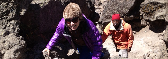 Stephanie Lawton climbing Kilimanjaro with Shedrack