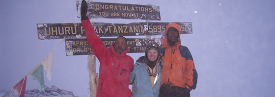 Joy Rikala at the top of Kilimanjaro with Hosea Samwel