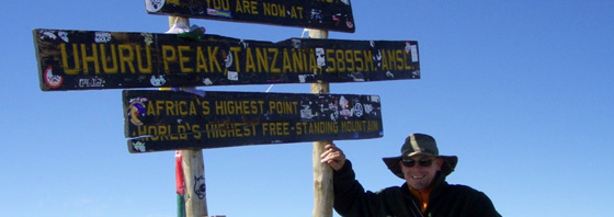David Sutton on the top of Kilimanjaro