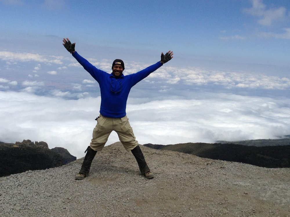 Kevin Jackson on the top of Kilimanjaro