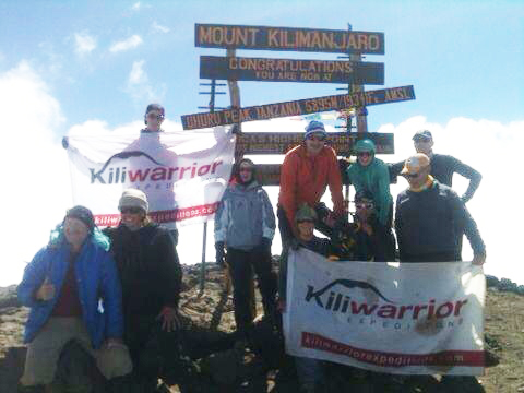 Brand Family at the top of Kilimanjaro