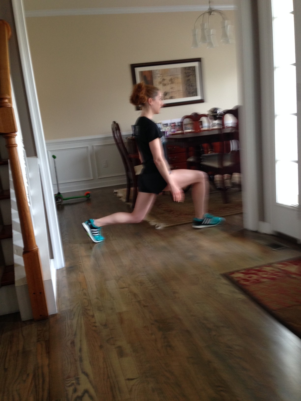 This is the position that causes the most pain - when the big toe is bent in lunges.  OUCH.  (blurry pic courtesy of my four year old)