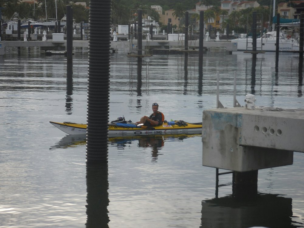 Kayaking around a marina looking for a place to stay.