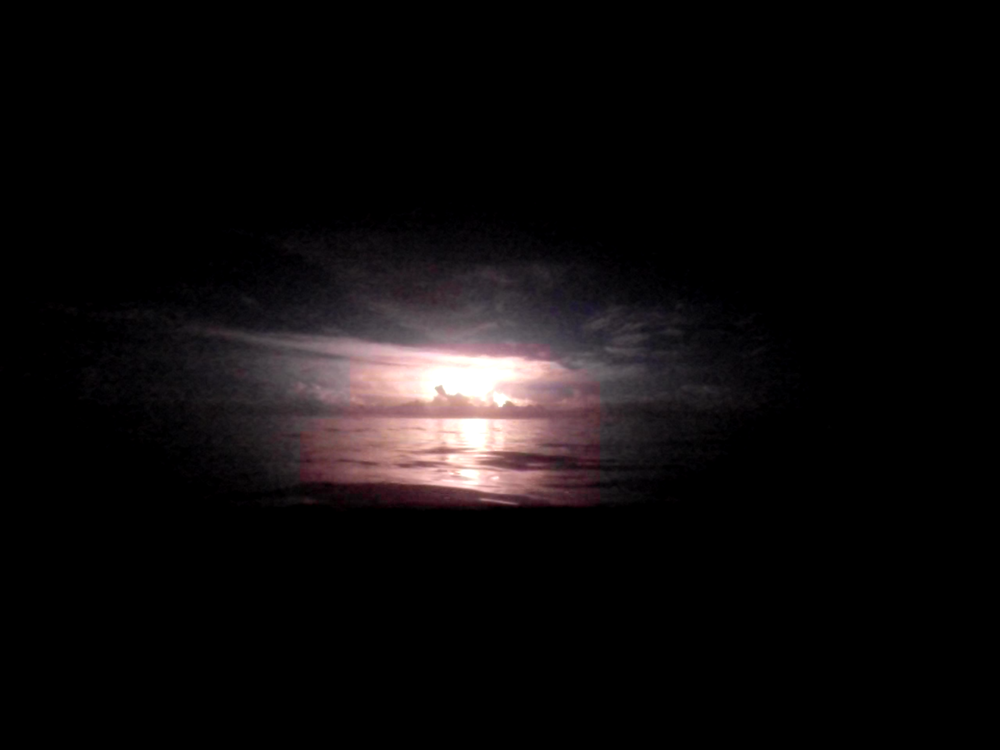 Lightening fills the night sky like a fireball (screenshot from GoPro footage)