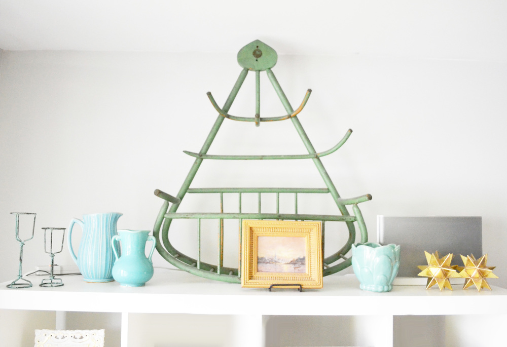 that cool green piece is an antique coat rack