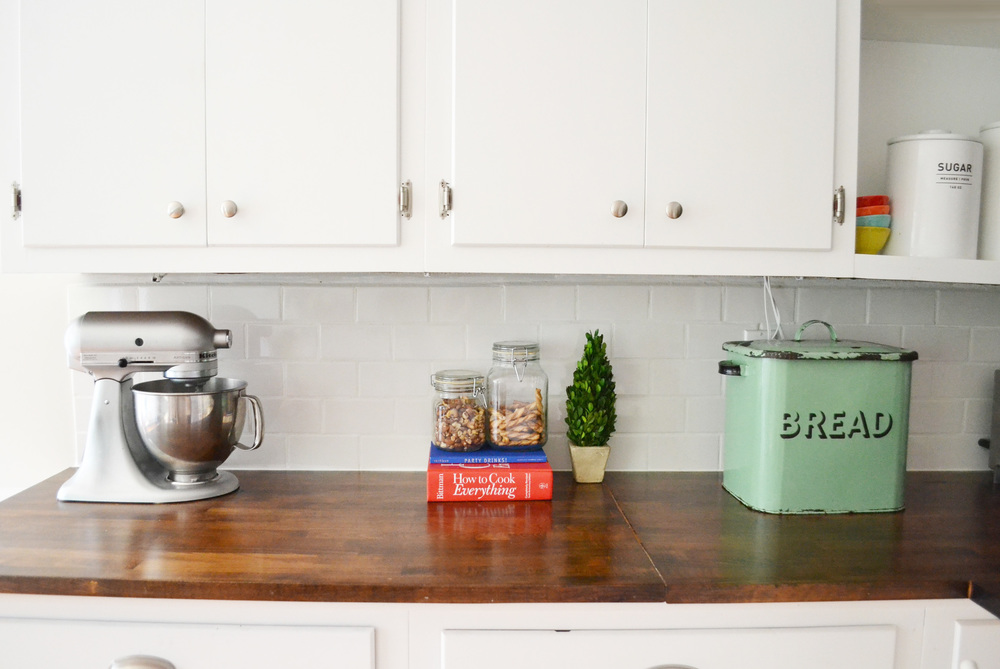 Cooper painted the cabinets herself and her husband hand-crafted their countertops from butcher block pieces at Ikea.