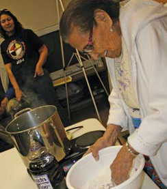Mary Watashe, Euchee, demonstrates how to make grape dumplings, a dessert considered a treat among many Southeastern tribes.