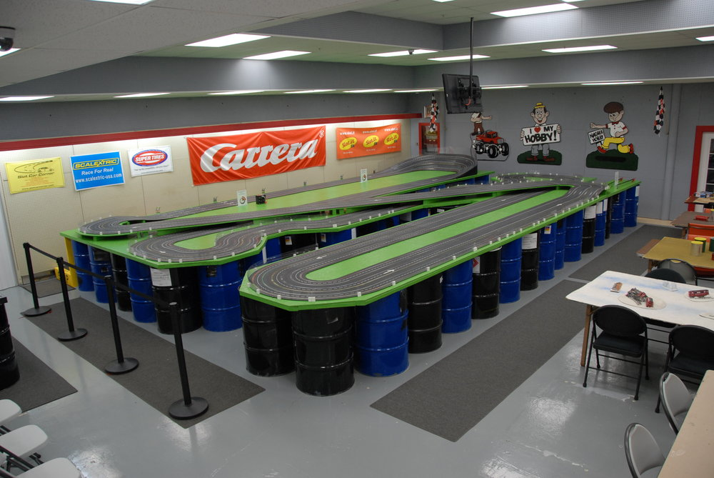 Our second 200ft+ six-lane Carrera analog slot car track (earlier version).  It's free to use every day.  We generally have two or three controllers for our guests to use; but, not always due to needed repairs, etc.  We do have controllers to purchase (US$51.99 to US$159.99).  When using the slot car track and there are others waiting to use the slot car track, we ask that guests limit their use to twenty (20) minutes and then permit others to enjoy the slot car track.  There are nights during the week when there are organized racing (club nights); anyone may participate in the club nights- they post their schedule on the bulletin board near the slot car track.