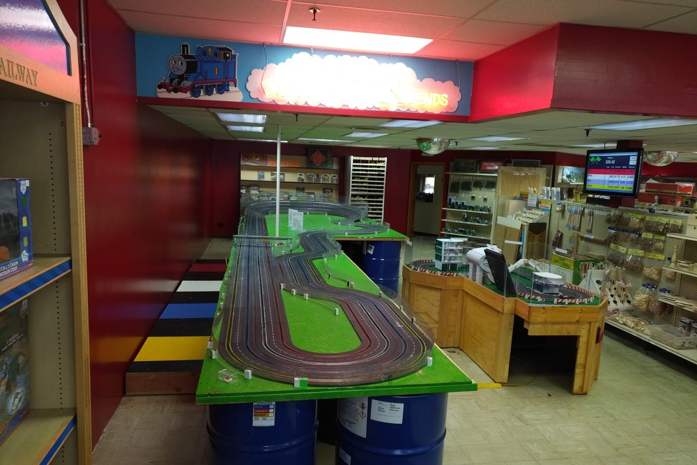 Our current Carrera Slot Car Track; resized due to newly-constrained space considerations.  It's four (4) lanes and remains free to use.