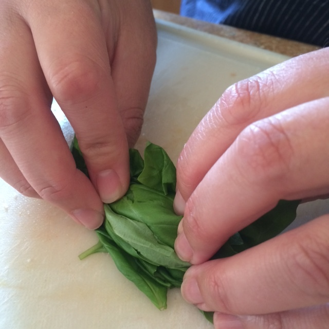 7. Julienne basil by rolling leaves into a cigar-like shape and then thinly slice.