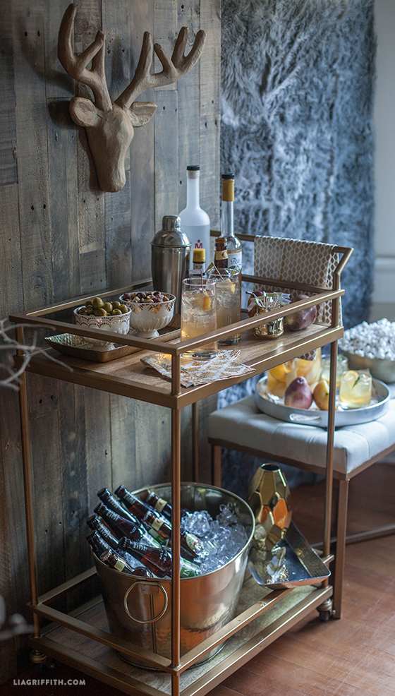 This bar cart is all ready for a party.  It was photographed by  Lia Griffith  is from  Target !