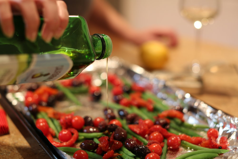 3. On a foil lined sheet, toss olives, roasted red peppers, and green beans with olive oil and pepper. (Do not sprinkle with salt!!! The sardines and olives take care of that!) Spread sardines over vegetables.