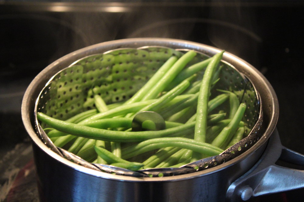 2. Steam green beans for 4 minutes, drain and run under cold water to stop cooking.