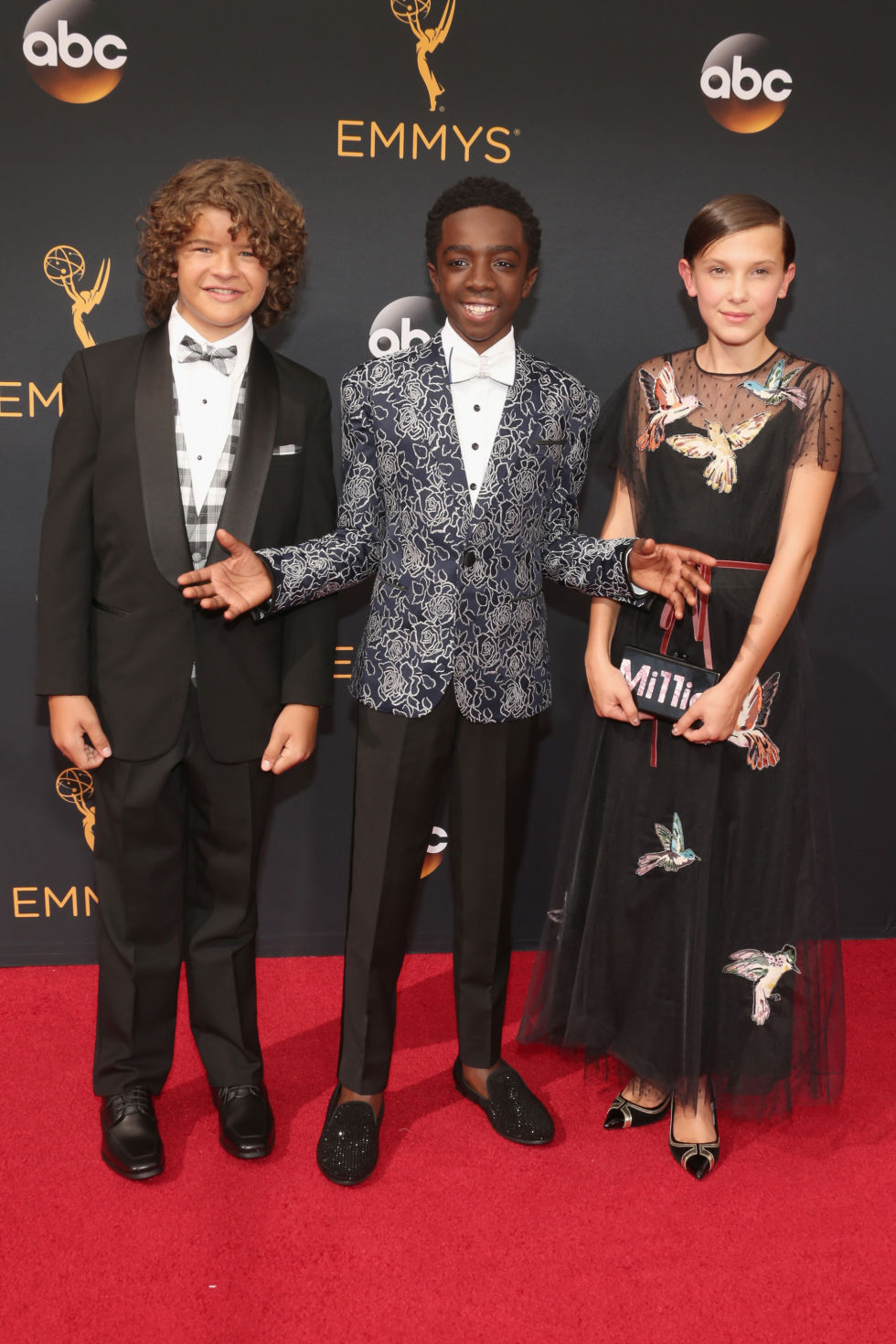 Gaten Matarazzo, Caleb McLaughlin, and Millie Bobby Brown in RED Valentino