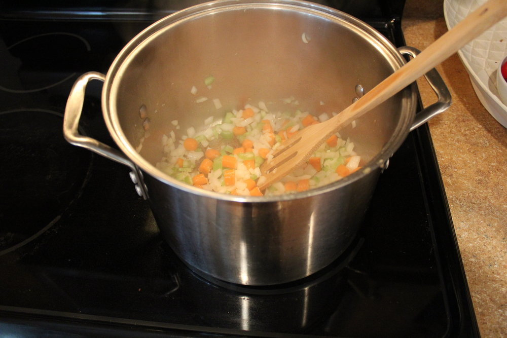 4. In the same pot you browned the chicken, heat 1 Tbs. of olive oil over medium heat and sautee carrots, celery, and carrots. Season with salt and pepper.