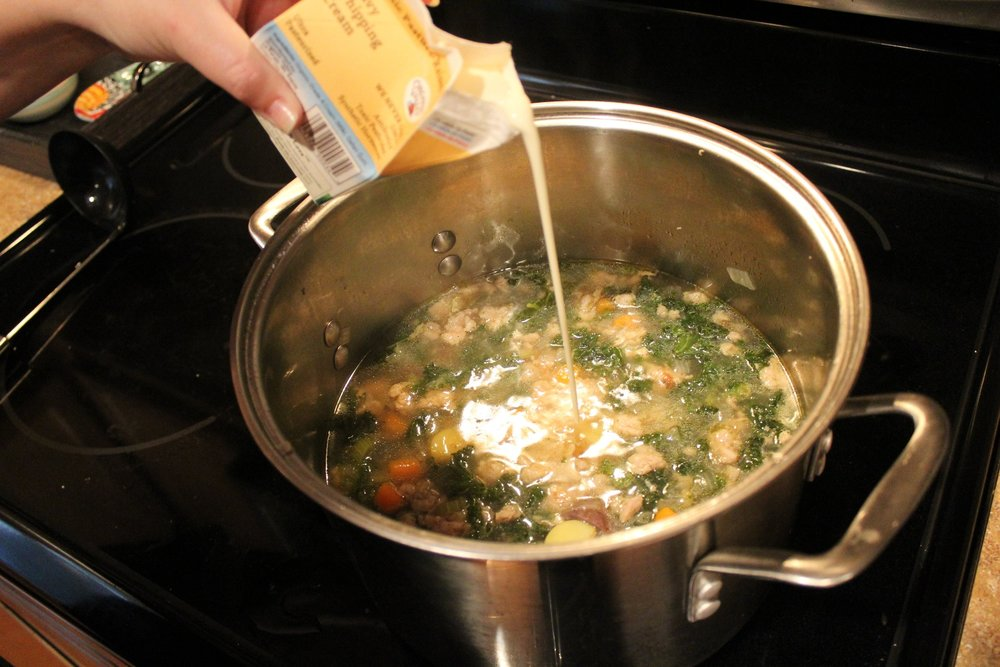 7. Add sausage and cream to pot, stir until heated through over low heat. Check seasoning and serve.
