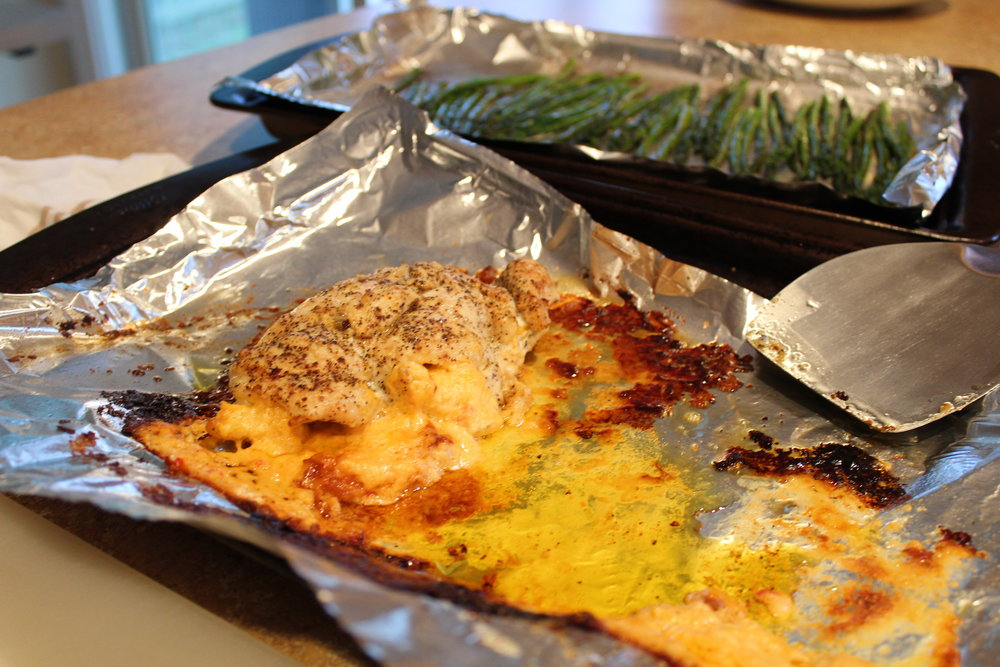 7.  Remove chicken from oven and let rest for 10 minutes.  Slice, plate, and top with the cheese that oozes out during cooking.  Even the crispy bits...those are the best part!