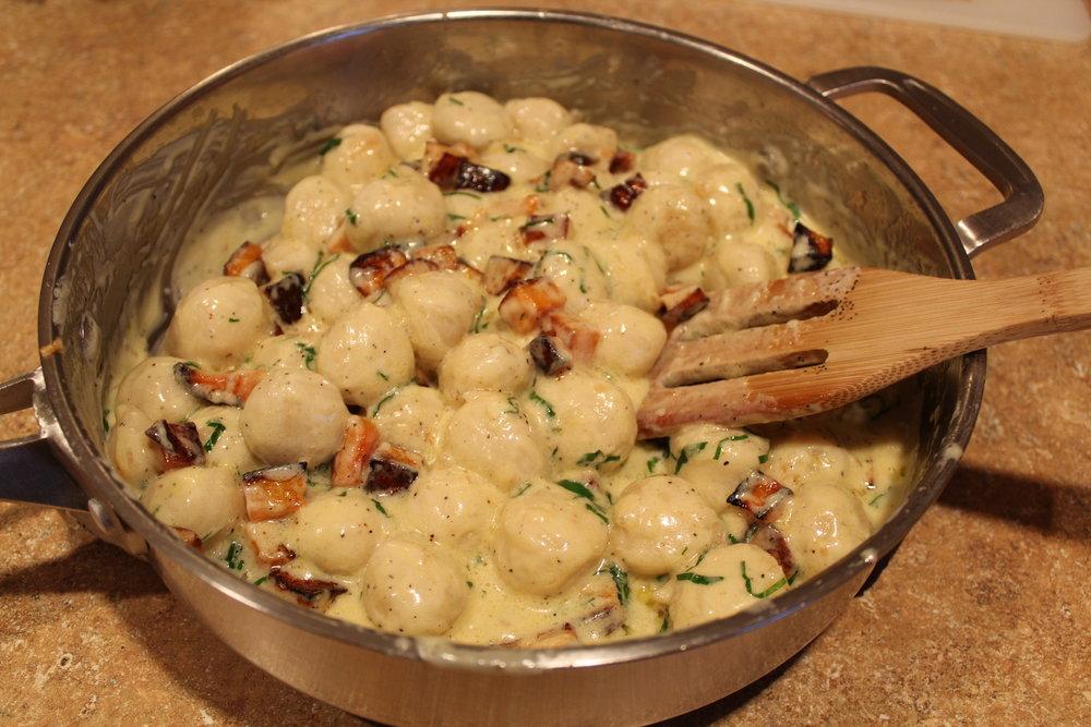 11. Add gnocchi, squash, and basil.