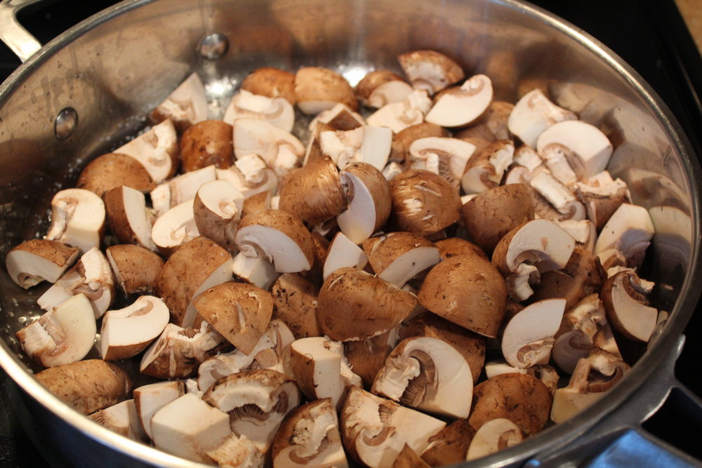 3. Heat 1 Tbs. olive oil over med/high heat, When pan is hot, add mushrooms and a pinch of salt.