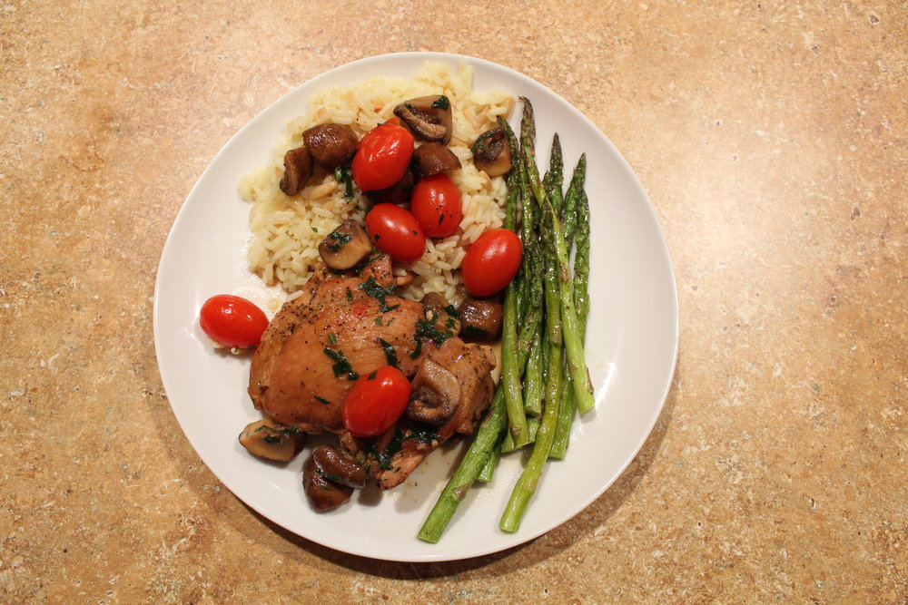 11. Plate your dish. I cooked Near East Rice pilaf and bake asparagus as side. Also, I poured the yummy marsala sauce all over top of everything  Enjoy!   Emily !