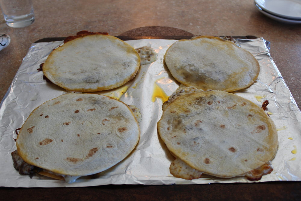 7.  Let quesadillas rest for a couple of minutes before cutting to serve.