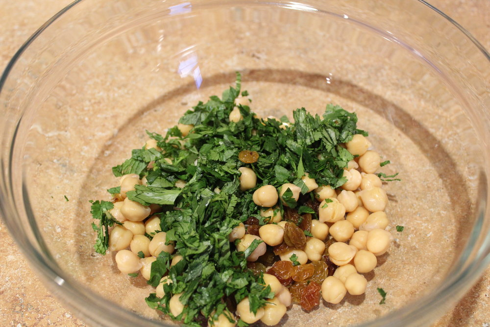 4. Mix together chickpeas, raisins, mint, cilantro, and chilled cauliflower..