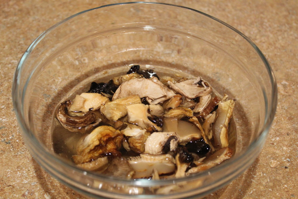 2. Pour warm water over dried mushrooms and let sit for 10 minutes.