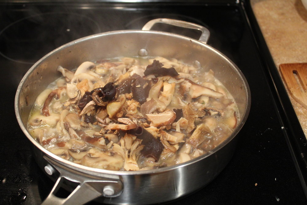 5. Add dried mushrooms, their liquid, salt and pepper to the pan and reduce for 10 minutes.
