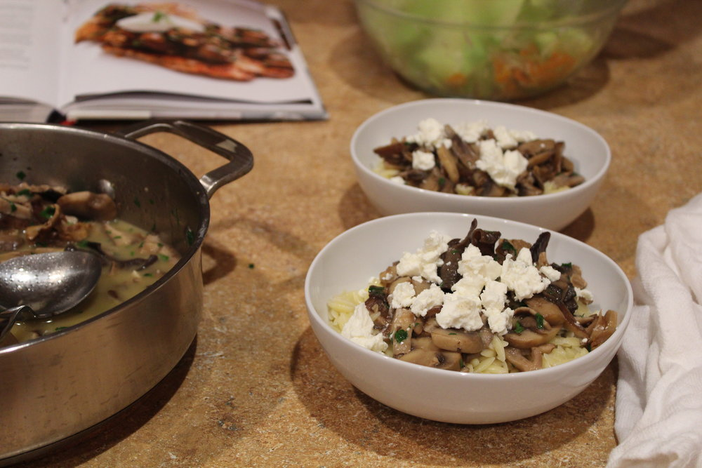 9. Place orzo in a bowl, top with mushroom mixture, and crumble goat cheese on top.