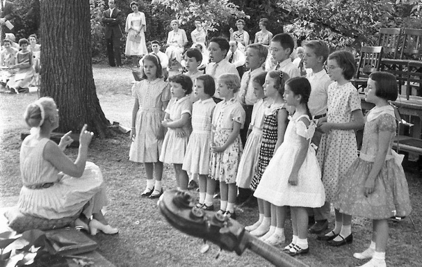 Harriet gratwick conducts children's chorus, circa 1955