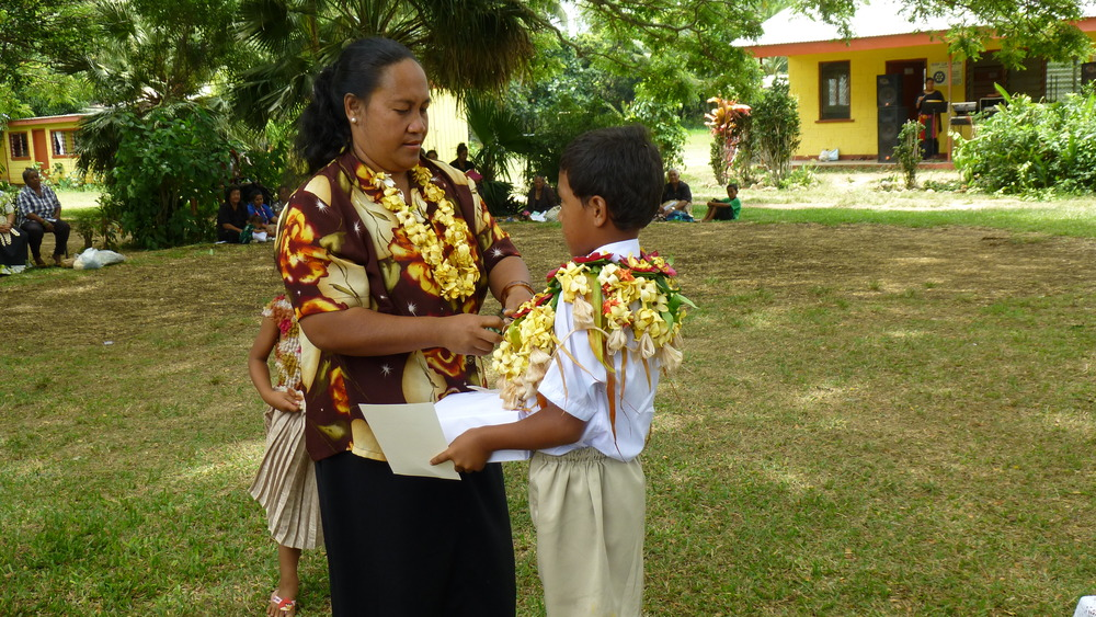 """My student's mother gifts him a """"kahoa"""" necklace at our school's graduation ceremony.(Tonga)"""