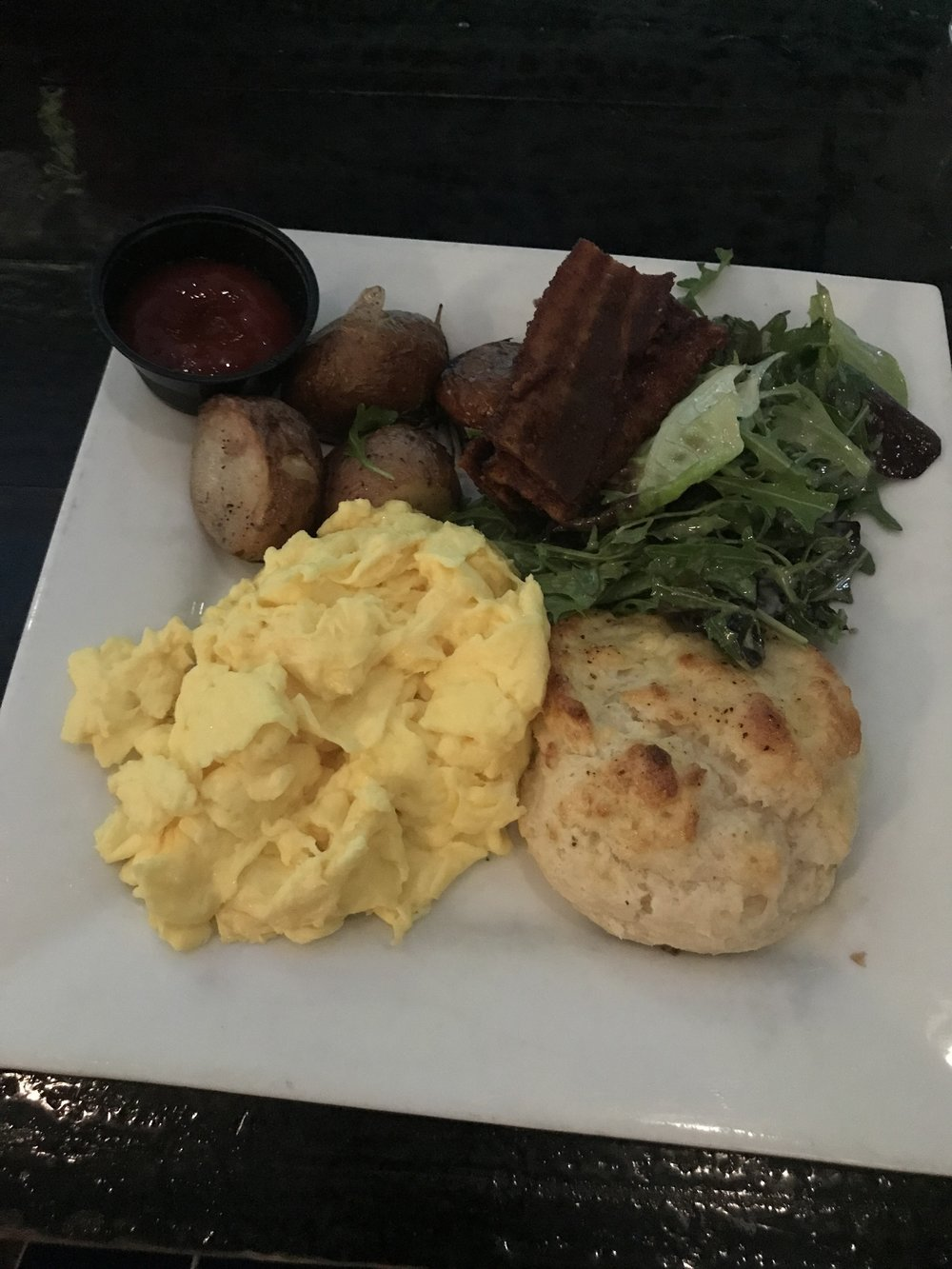 Scrambled Eggs with a side of Sassy Bacon - $18
