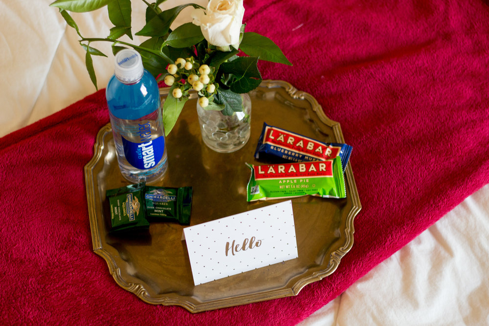 Essentials:  A fresh flower and trimmings from my orange tree, Water, LARABAR, Ghirardelli dark chocolate mints, a welcome card with wi-fi password