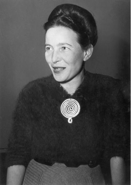 Simone de Beauvoir, wearing an Alexander Calder necklace, 1955