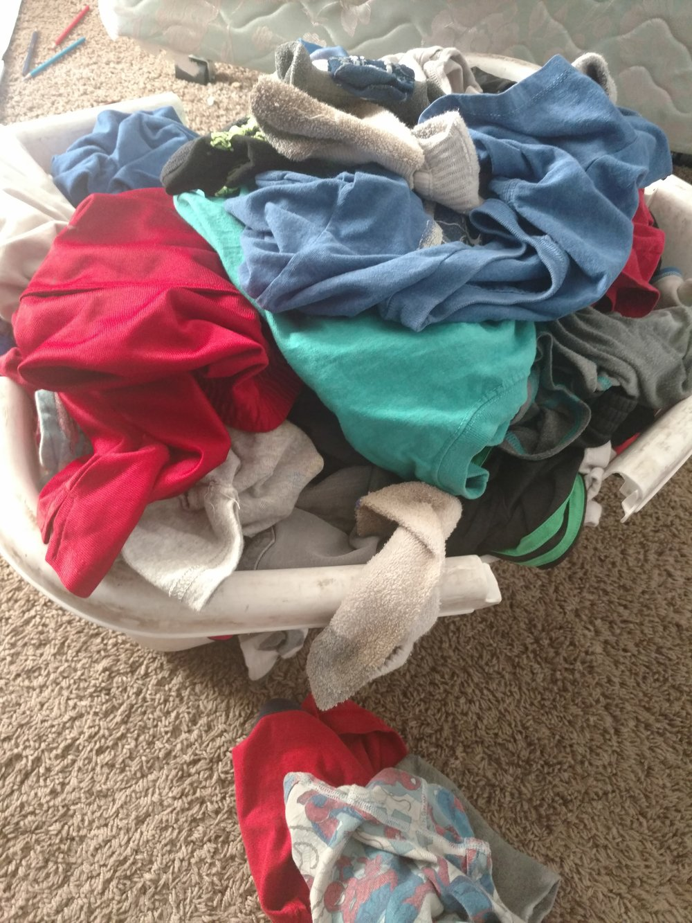 Here is a basket of clean clothes from my little boys. I laughed when I looked at the shape of my laundry basket. Apparently, I need to get some new ones because these are 17 years old and completely falling apart.