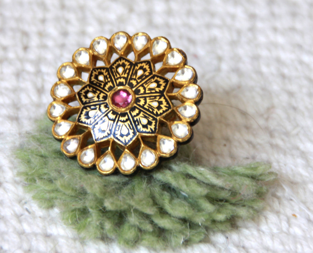 Diamond Flower Power, signature black and gold hand-enameled ring with floral motifs,rose cut diamonds and rhodolite gemstones.