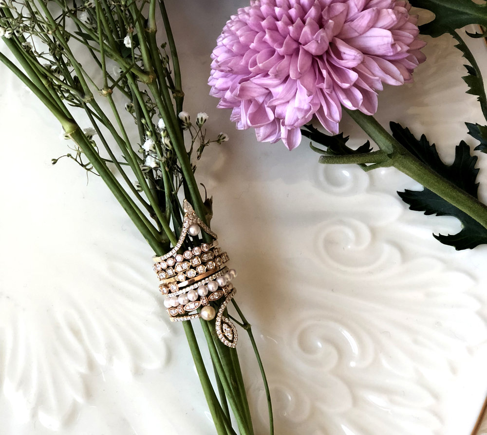 Diamond essentials and pearl stackable rings in gold.