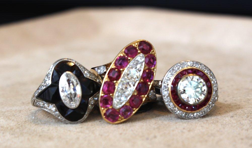 Art Deco Tiffany black onyx and diamond ring.   Edwardian ruby and diamond ring.   Diamond and ruby target ring.